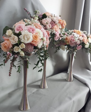 A trio of elegant centerpieces featuring sherbet hues is perfect for a spring event.