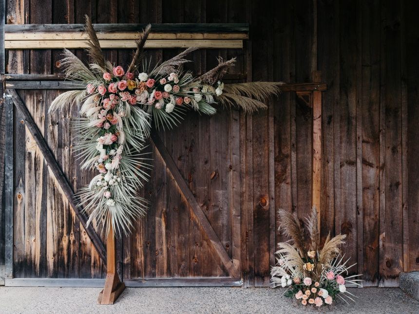 Floral arbor with dried materials for barn wedding